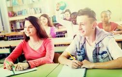 Allievi della scuola che prendono una lezione Fotografia Stock