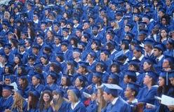 Allievi di laurea in protezione ed abiti Fotografie Stock Libere da Diritti