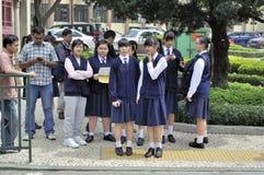 Allievi femminili della Macao Immagine Stock
