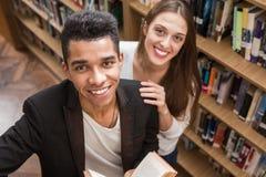 Allievi in libreria Fotografia Stock