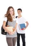 Allievi sorridenti della High School su priorità bassa bianca Immagine Stock