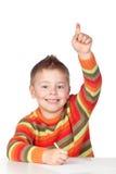 Allievo adorabile del bambino che chiede la parola Immagini Stock Libere da Diritti