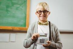 Allievo agghindato come insegnante che mostra calcolatore Immagine Stock Libera da Diritti