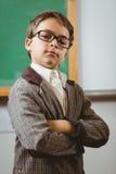 Allievo agghindato come insegnante con le armi attraversate Fotografia Stock Libera da Diritti