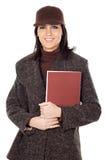 Allievo attraente della signora con il libro Fotografia Stock