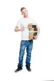 Allievo che tiene una pila di libri isolati su bianco Fotografia Stock Libera da Diritti