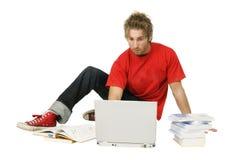 Allievo con il computer portatile ed i libri Immagine Stock Libera da Diritti
