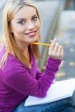 Allievo con il taccuino e la matita Immagini Stock Libere da Diritti