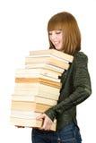 Allievo con una pila di libri Fotografie Stock