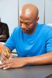 Allievo dell'afroamericano che cattura prova Immagine Stock Libera da Diritti