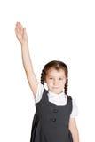 Allievo della scuola elementare che solleva la sua mano Immagine Stock