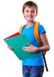 Allievo della scuola elementare con lo zaino ed i libri Fotografia Stock