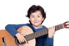 Allievo di musica che gioca la chitarra Fotografie Stock Libere da Diritti