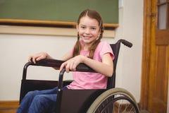 Allievo disabile che sorride alla macchina fotografica Immagine Stock Libera da Diritti