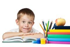 Allievo divertente con i libri e le matite Fotografie Stock