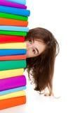 Allievo e mucchio dei libri Immagini Stock