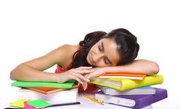 Allievo faticoso che dorme sui libri Fotografia Stock