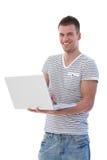 Allievo felice con sorridere del computer portatile Fotografia Stock