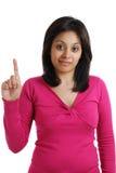 Allievo femminile che conta ad uno Immagine Stock