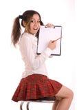 Allievo femminile che scrive e che mostra il modulo Fotografia Stock Libera da Diritti