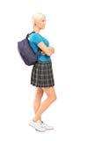 Allievo femminile che si leva in piedi nel profilo Fotografia Stock