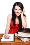 Allievo femminile che sorride con i libri Fotografie Stock Libere da Diritti