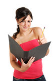 Allievo femminile che tiene un dispositivo di piegatura e una matita Immagine Stock Libera da Diritti