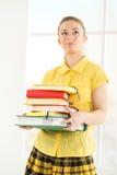 Allievo femminile con i libri Fotografia Stock