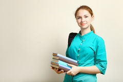Allievo femminile con i libri Immagini Stock Libere da Diritti