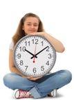 Allievo femminile con il grande orologio Fotografia Stock