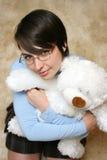 Allievo grazioso con l'orso di orsacchiotto Immagine Stock