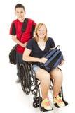 Allievo invalido e fratello Fotografia Stock