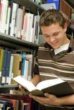 Allievo in libreria Fotografie Stock