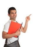 Allievo maschio che indica la sua barretta il vostro messaggio Immagini Stock Libere da Diritti