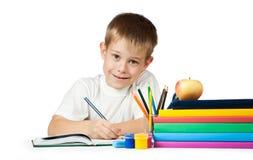 Allievo piacevole con i libri e le matite Immagine Stock Libera da Diritti