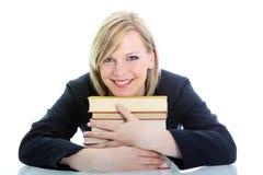 Allievo sorridente che abbraccia i suoi libri Fotografia Stock