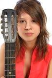 Allievo sorridente con una chitarra Immagini Stock Libere da Diritti