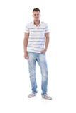 Allievo sportivo nel sorridere dei jeans Fotografia Stock