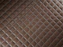 Alligator or crocodile brown Leather Square stitched texture. Alligator or crocodile brown Leather. Square stitched texture or background with bumps. 3d render royalty free illustration