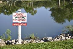 Alligator danger sign Stock Photos