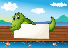 An alligator holding an empty signboard at the lake with fish. Illustration of an alligator holding an empty signboard at the lake with fish Stock Photos