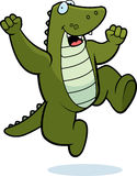 Alligator Jumping. A happy cartoon alligator jumping and smiling Stock Images