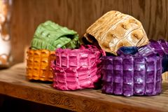 Colorful rolls of alligator skin, texture stock photo