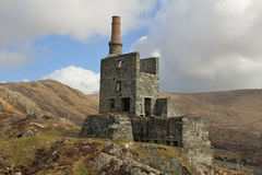 Allihies copper mine engine house Ireland. On a rocky hill royalty free stock photo