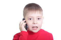 Allo. Kid in red shout to mobile isolated Stock Image