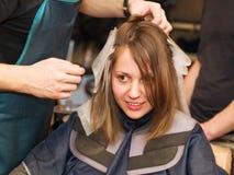 Allo studio dei capelli Immagine Stock