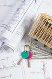 Alloggi in costruzione, chiavi, dollaro di valute e disegni elettrici, concetto della casa della costruzione Fotografia Stock Libera da Diritti