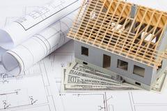 Alloggi in costruzione, dollaro di valute e disegni elettrici, concetto della casa della costruzione Fotografie Stock