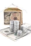 Alloggi fatto dei dollari con le monete d'argento Fotografia Stock Libera da Diritti