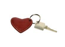 Alloggi i tasti con un anello chiave del cuore rosso Fotografie Stock